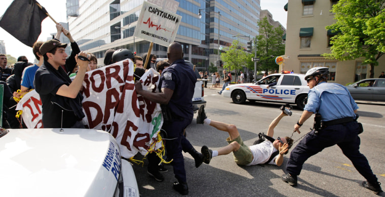 Protesters clash with law enforcement officers during a protest against the International Monetary Fund in Washington, D.C., on Saturday.