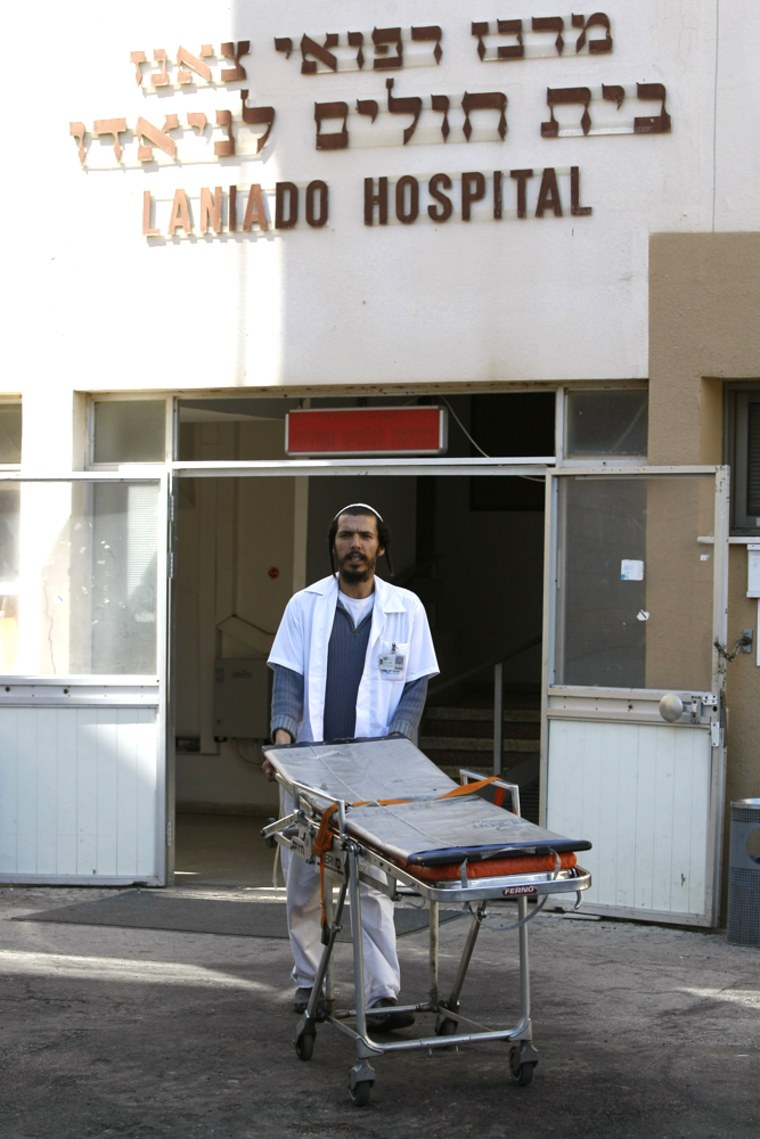 Image: A medic pushes an empty trolley at the Laniado hospital