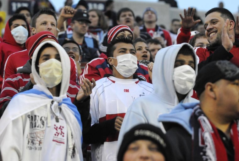 Image: Soccer fans wear protective masks during a match between the Chicago Fire and Club America