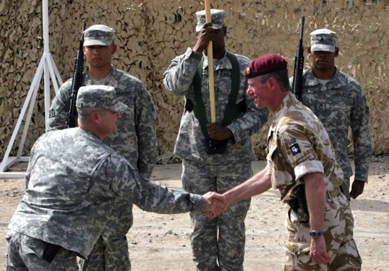 Image: Commander 20th Armoured Brigade, Brigadier Tom Beckett shakes hands with Colonel Henry A Kievenaar, US Commander 2-4 BCT