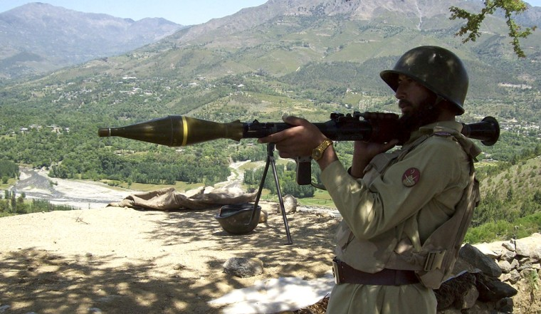 Image: Pakistani paramilitary soldier poses with rocket launcher
