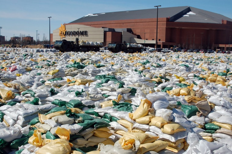 Sandbags cover the parking lot of the Fargodome, an indoor football stadium and concert arena in Fargo, N.D., Thursday, April 9.