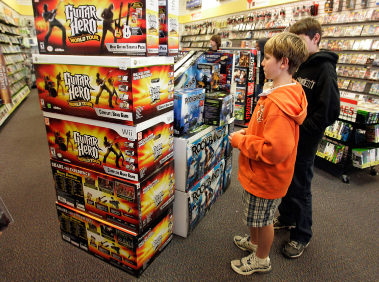 Image: Guitar Hero and Rock Band 2 video game bundles are seen on display at a GameStop store in Redwood City, Calif.