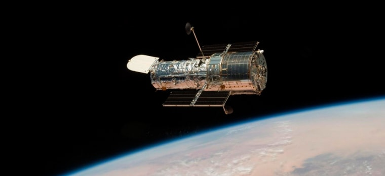 Image: Shuttle mission astronauts work on Hubble repairs