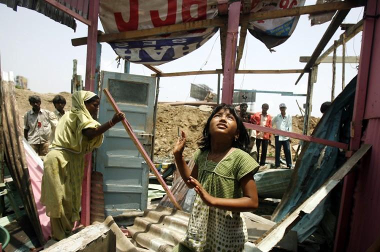 Image: Rubina Ali looks around as her house gets demolished by local authorities in Mumbai