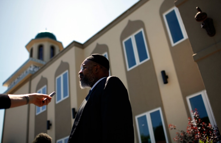 Image: Imam Salahuddin speaks to reporters outside Masjid Al Ikhlas mosque in New York