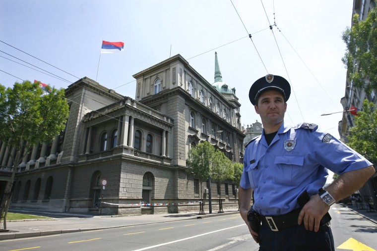 Image: A policeman stands in front of the Serbian Presidency building in central Belgrade