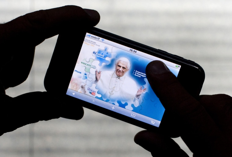 Image:  iPod Touch displays official Vatican internet portal with an image of Pope Benedict XVI in Rome