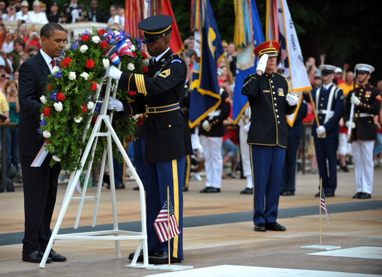 Image: U.S. President Barack Obama takes part in a wreath laying ceremony