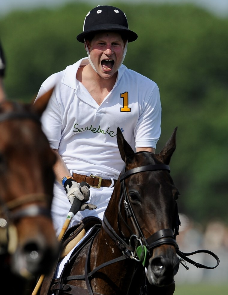 Image: Prince Harry reacts while playing in the second annual Veuve Clicquot Manhattan Polo Classic