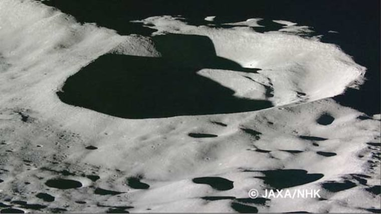 A large crater reveals the harsh light and shadow created on the lunar landscape as sunlight fight no atmosphere.
