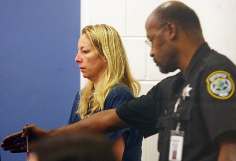 Bonnie Sweeten, left, claimed she and her daughter had been kidnapped by two black men but instead turned up at Walt Disney World. She is shown here at the Orange County, Fla.jail.