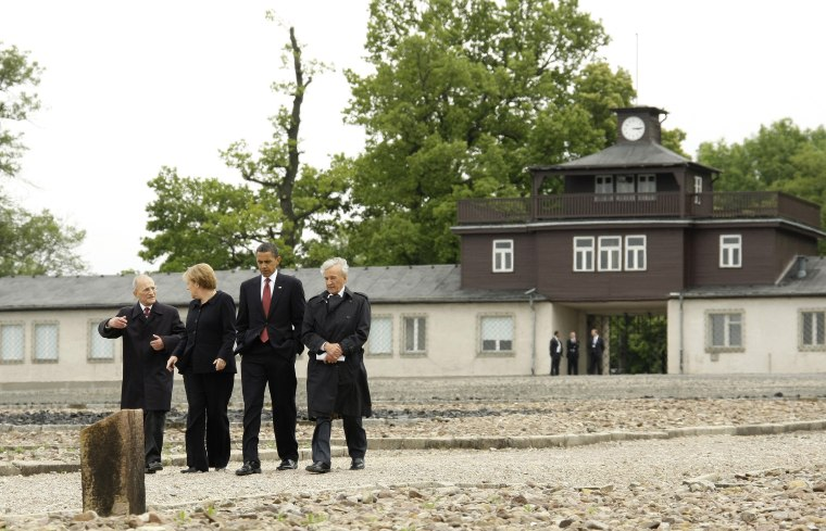 Image: US President Obama and German Chancellor  Merkel listen to Holocaust survivors during visit to former Buchenwald Nazi concentration camp