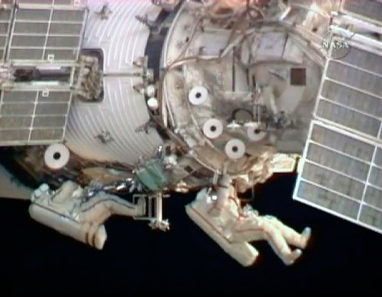 Image: Flight engineer Barratt and Commander Padalka work side by side during their spacewalk from the International Space Station i
