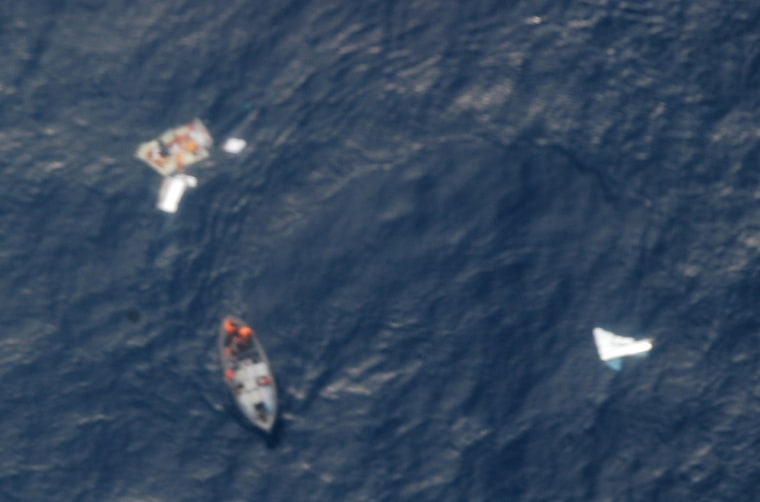 In a photo released Saturday by Brazil's air force, a Brazilian Navy ship, bottom left, approaches debris believed to be from Air France Flight 447 in the Atlantic Ocean.