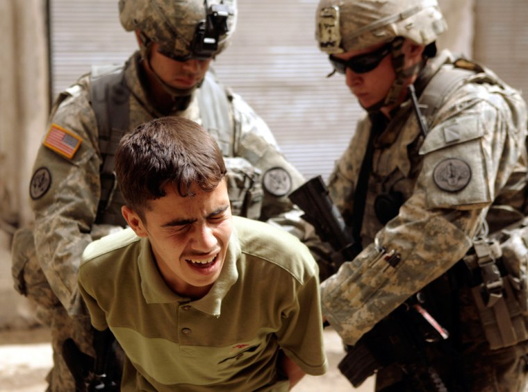 U.S. Army soldiers detain an Iraqi teenager after a rocket propelled grenade attack on U.S. troops in Mosul, northwest of Baghdad.