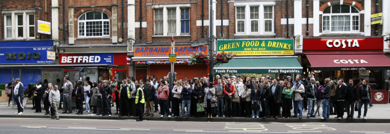 Image: Commuters queue for buses in Shepherds Bush in west London