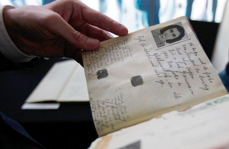 Image: Dutch Minister of Education Ronald Plasterk looks at a facsimile of Anne Frank's dairy after a news conference in Amsterdam