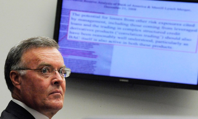 Image: Lewis looks at a memo being projected on the walls during testimony before the House Oversight and Government Reform Committee in Washington