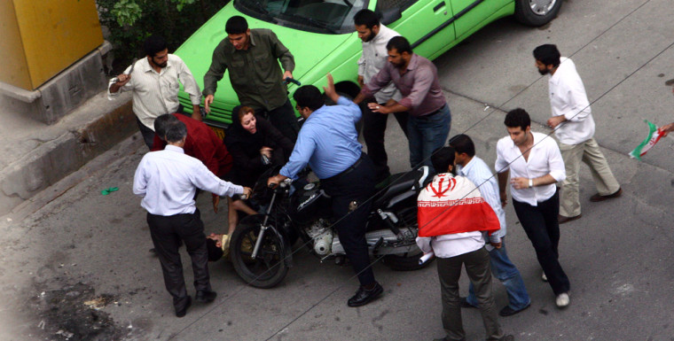 Image: Iranian supporter of Mir Hossein Mousavi is beaten by government security members