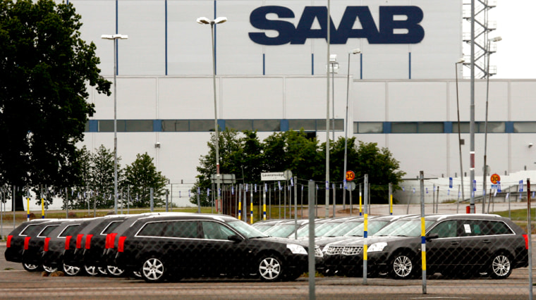 Image: New Saab automobiles are parked in a storage lot outside the main factory in Trollhattan