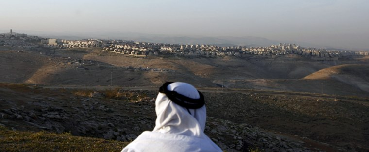 Image: A Palestinian man looks towards the Jewish settlement of Maale Adumim