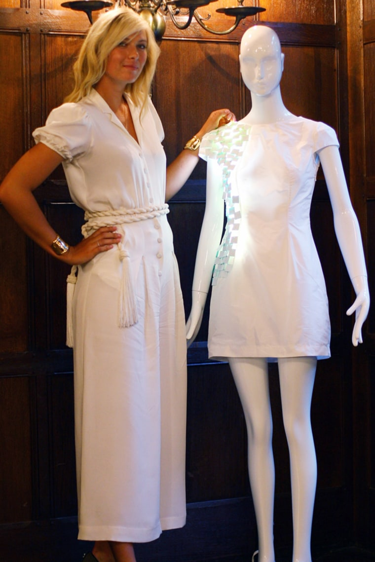 Image: Maria Sharapova displays the winning design from the London College of Fashion