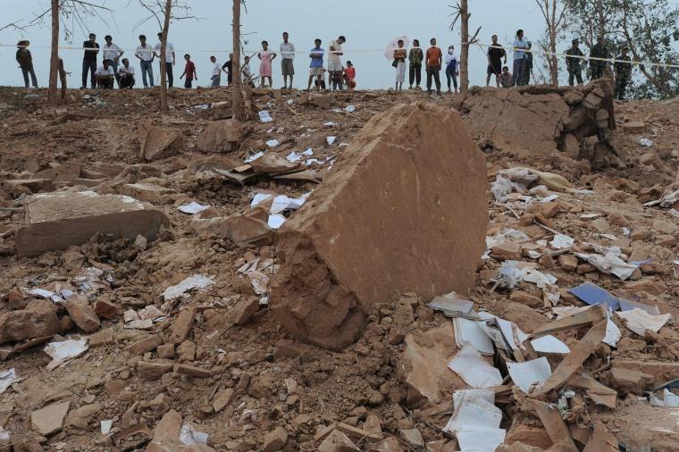 Image: Factory blast kills at least 16