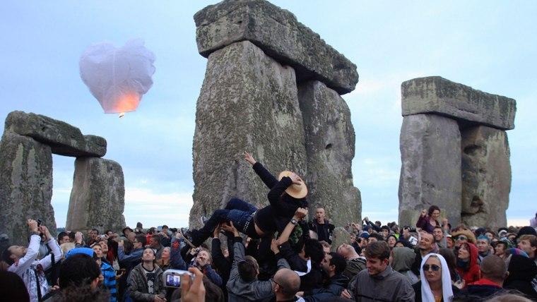 Image: Revellers celebrate summer solstice at Stonehenge