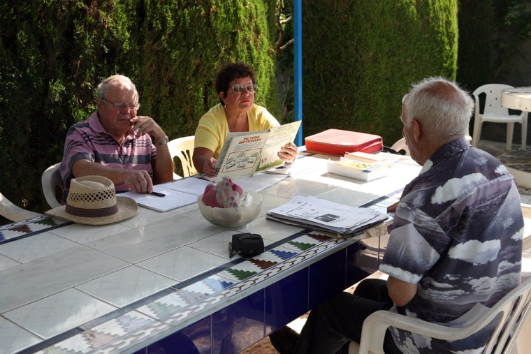 Gill Burden, center, and Michael Trump, left, who moved to southern Spain about three years ago, attend one of their weekly Spanish lessons. The falling pound, collapsing house prices and dwindling pension income have virtually trapped the two British retirees.