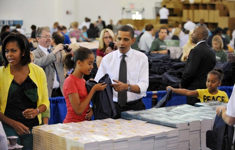 Image: Barack Obama Michelle Obama with daughters Sasha and Malia