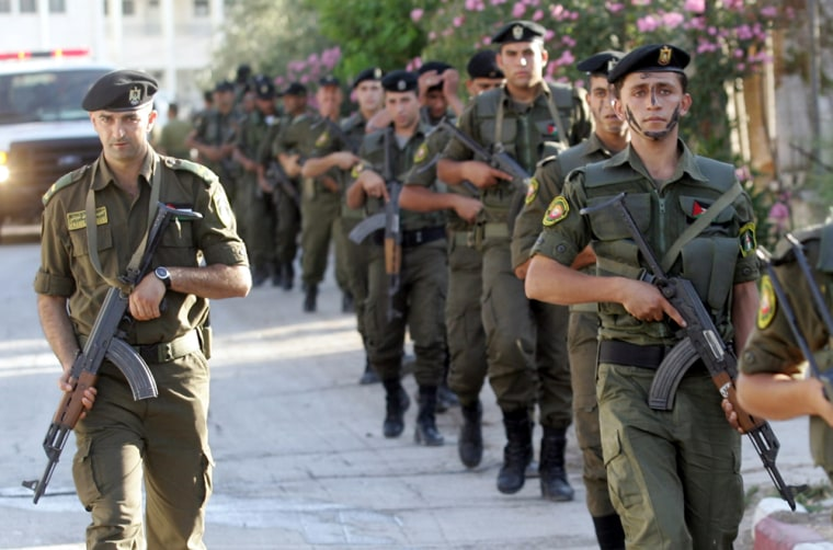 Palestinian security forces patrol the West Bank town of Jenin on June 18.