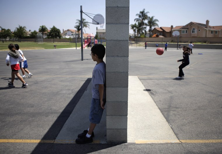 Image: Students play on the playground during a lunch break at Rolling Ridge Elementary School