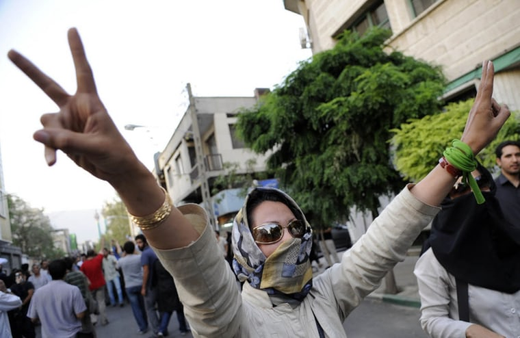 Image: A supporter of pro-reform leader Mir Hossein Mousavi, flashes victory signs during a gathering near Ghoba Mosque in Tehran, Iran