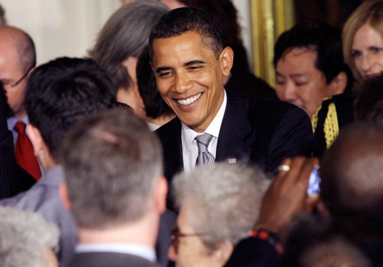 Image: Barack Obama greets guests
