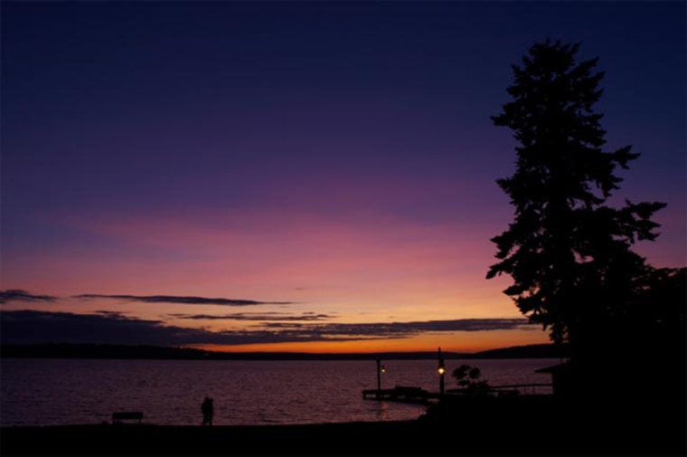 This sunset in Kirkland, Wash., captured on June 28 shows the characteristic purple sunsets created after a volcano spews gas and ash into the atmosphere.
