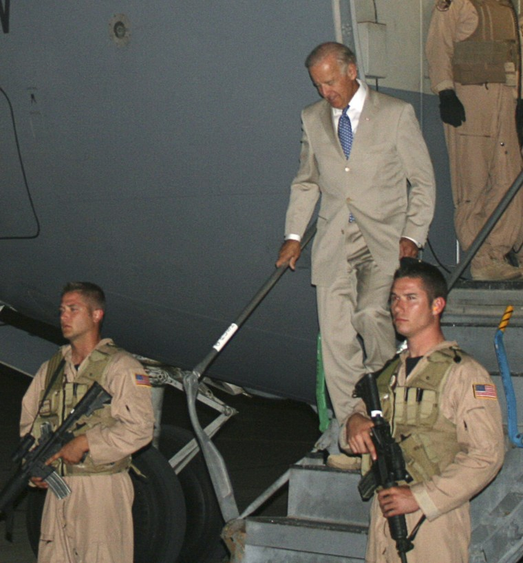 Image: United States Vice-President Joe Biden arrives in Baghdad, as security personnel stand guard