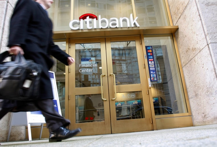 Image: A pedestrian passes by a Citibank in downtown Boston.
