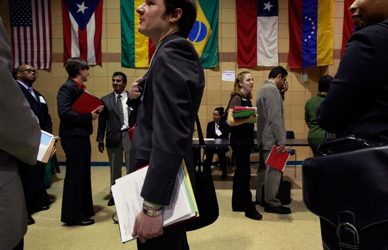 Image: Job seekers wait in line to speak to a recruiter during a job fair held by the City Colleges of Chicago June 4, 2009 in Chicago.
