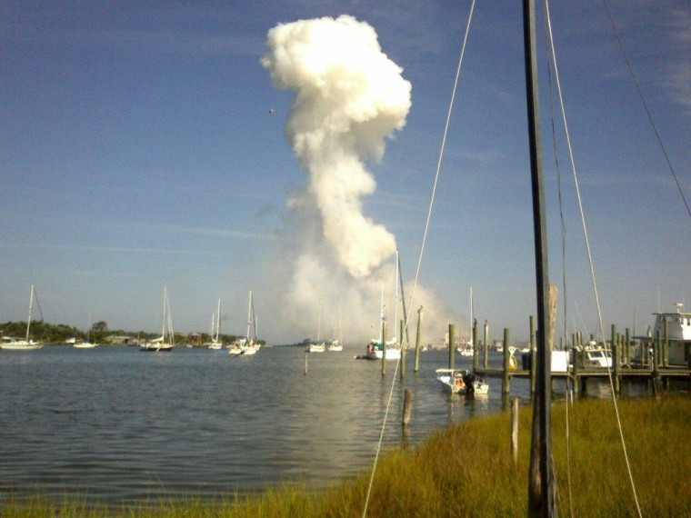 Image: Smoke is seen across Ocracoke Island, N.C. Saturday, July 4, 2009 after a truckload of fireworks exploded
