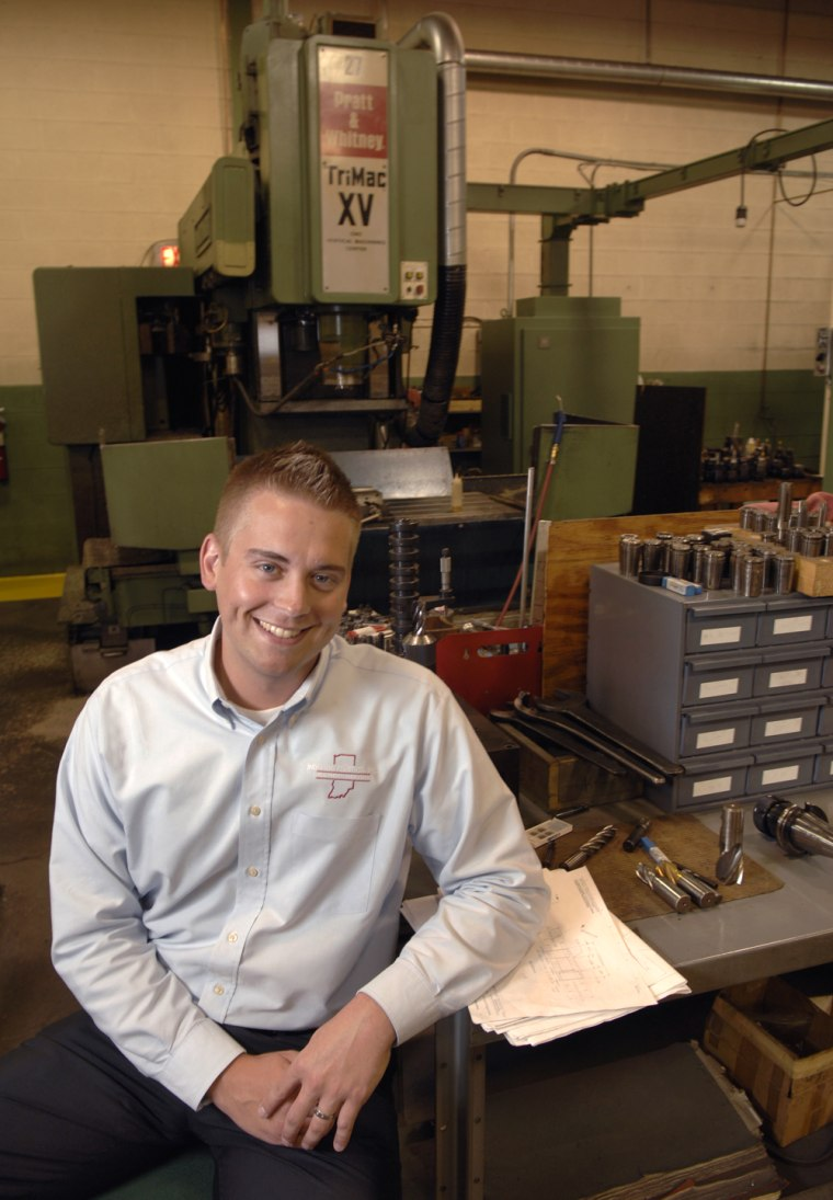 Chris Burkhead, shownin the machine shop of Kruis Mold and Engineering, says attention to qualityis the secret ofhis family'ssuccess in manufacturing.