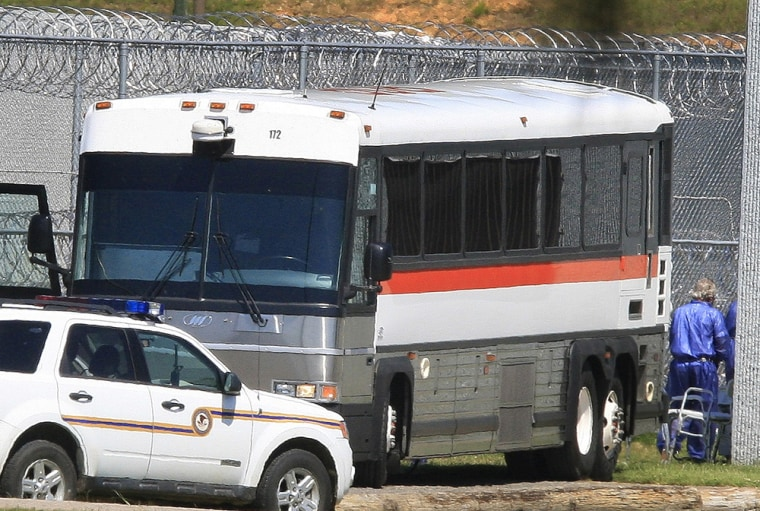 Image: Prisoners are unloaded at Butner Federal Correctional Complex in Butner, N.C.