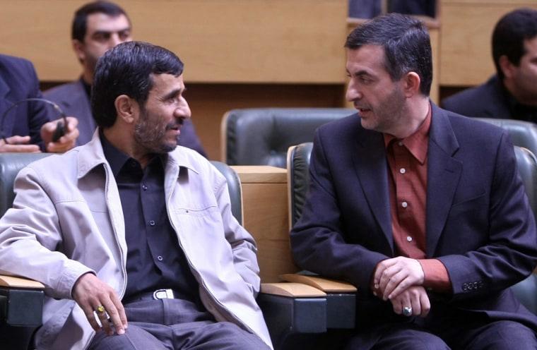 Image: Iranian President Mahmoud Ahmadinejad, left, speaks with the then Vice-President Esfandiar Rahim Mashai