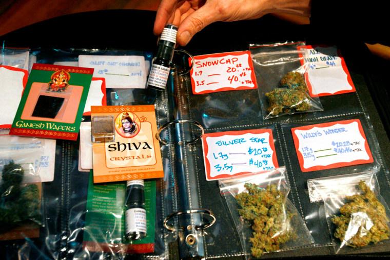 Image: A binder showcasing high-grade marijuana buds at the Coffeeshop Blue Sky dispensary