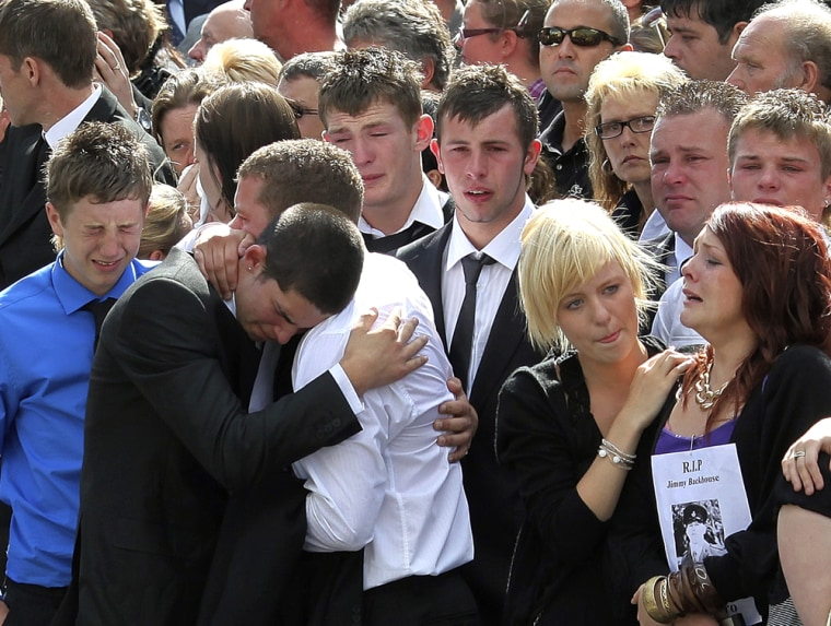 Image: Friends of  fallen serviceman Jimmy Backhouse mourn