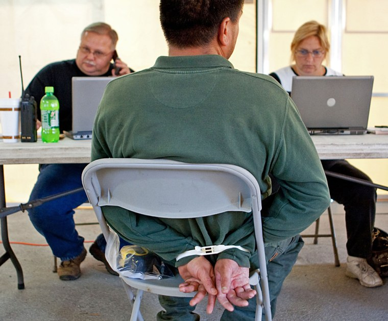 Image: Jacksonville Sheriff's Officers process a contractor