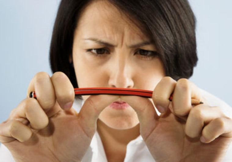 Imnage: Woman bending pencil