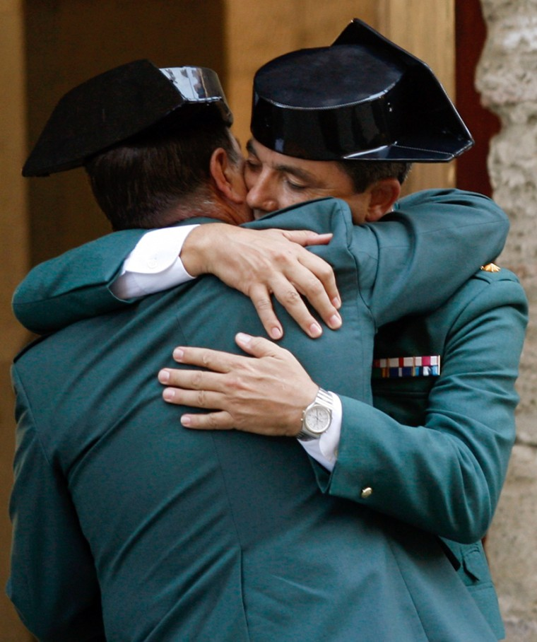 Image: Spanish Civil Guards attend the vigil for two fellow officers who were killed in an attack in Palma de Mallorca