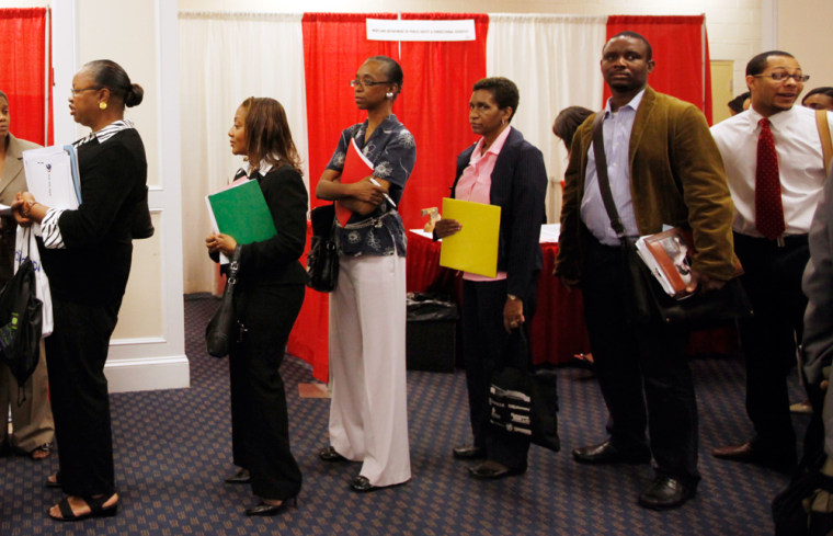 Image: Attendees line up for a job interview