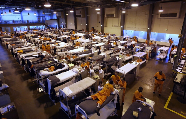 Image: Several hundred inmates crowd the gymnasium at San Quentin prison in San Quentin, Calif.